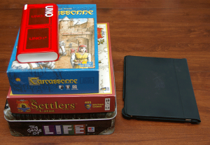 Game Boxes Next to an iPad